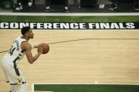 Milwaukee Bucks' Giannis Antetokounmpo shoots a free throw during the first half of Game 2 of the NBA Eastern Conference basketball finals game Friday, June 25, 2021, in Milwaukee. (AP Photo/Morry Gash)