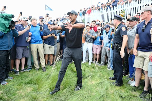 Tiger Woods of the United States prepares to play his shot from the rough on the first hole during the second round of the 2019 PGA Championship at the Bethpage Black course on May 17, 2019 in Farmingdale, New York. (Photo by Jamie Squire/Getty Images)