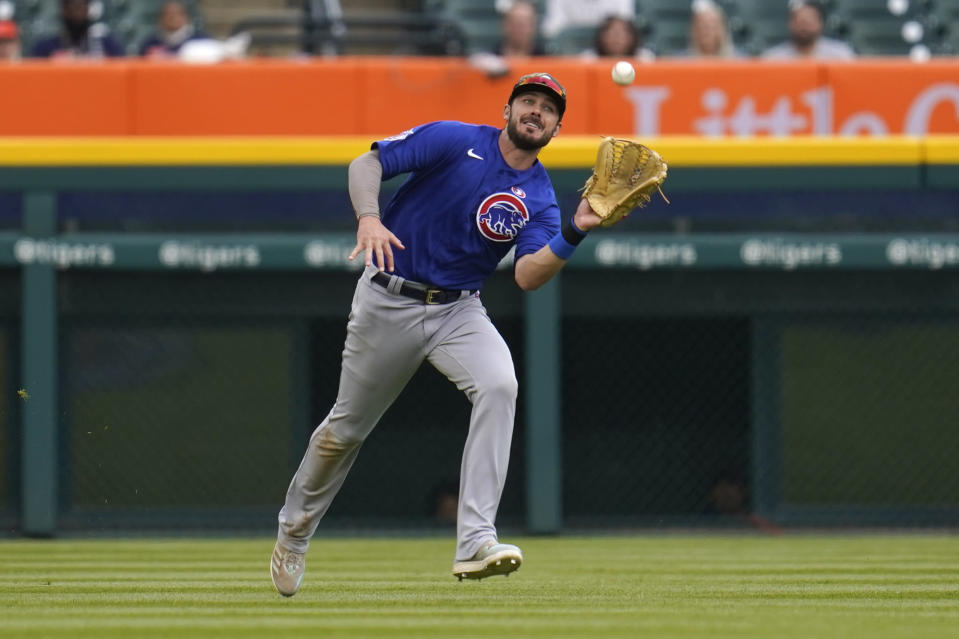 Chicago Cubs' Kris Bryant catches a Detroit Tigers' Nomar Mazara fly ball in the sixth inning of a baseball game in Detroit, Saturday, May 15, 2021. (AP Photo/Paul Sancya)