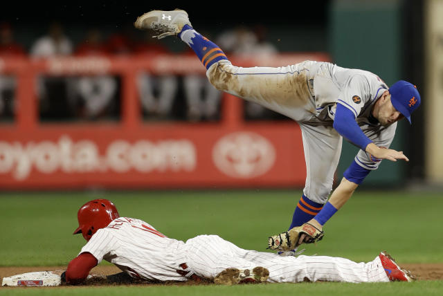 New York Mets second baseman Jeff McNeil, top, cannot reach Philadelphia Phillies' Cesar Hernandez as Hernandez steals second during the first inning of a baseball game Tuesday, Sept. 18, 2018, in Philadelphia. (AP Photo/Matt Slocum)