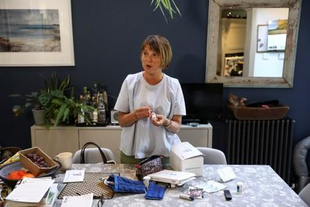 Georgina shows off her insulin medical supplies at her home in London
