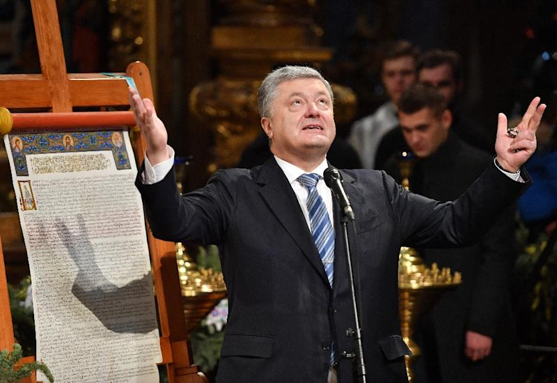 Ukrainian President Petro Poroshenko attended the service in Kiev's most ancient church, the 11th-century Saint Sophia's Cathedral