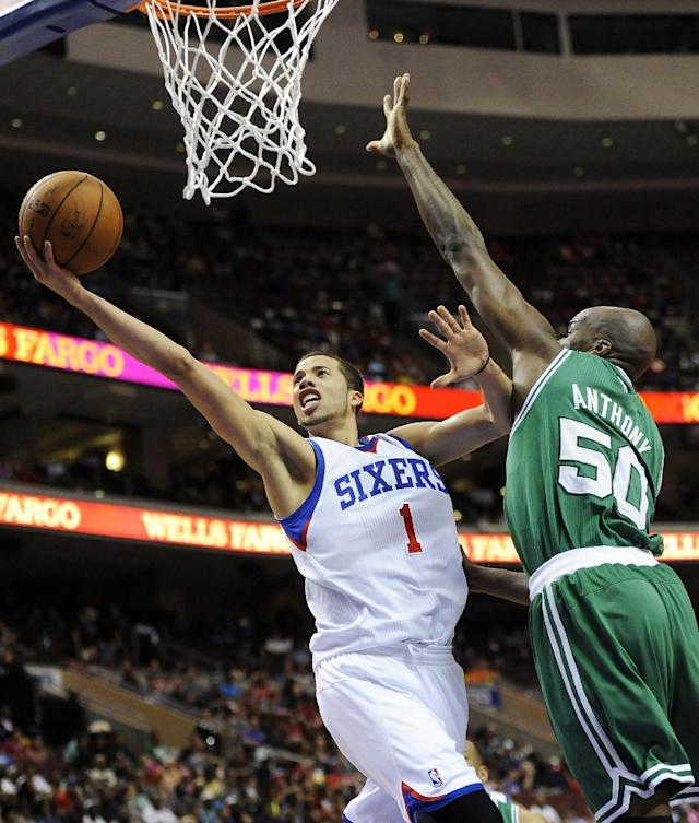 FILE - In this April 14, 2014 file photo, Philadelphia 76ers' Michael Carter-Williams (1) drives to the basket past Boston Celtics' Joel Anthony (50) during the second half of an NBA basketball game in Philadelphia. Carter-Williams has won the NBA's Rookie of the Year Award. The league said Monday, May 5, 2014, that he received 104 of a possible 124 first-place votes. (AP Photo/Michael Perez, File)