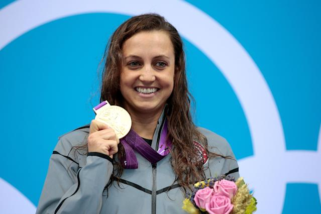 old medallist Rebecca Soni of the United States poses on the podium during the medal ceremony for the Women's 200m Breaststroke Final on Day 6 of the London 2012 Olympic Games at the Aquatics Centre on August 2, 2012 in London, England. Soni set a new world record time of 2:19.59 for the event. (Photo by Adam Pretty/Getty Images)