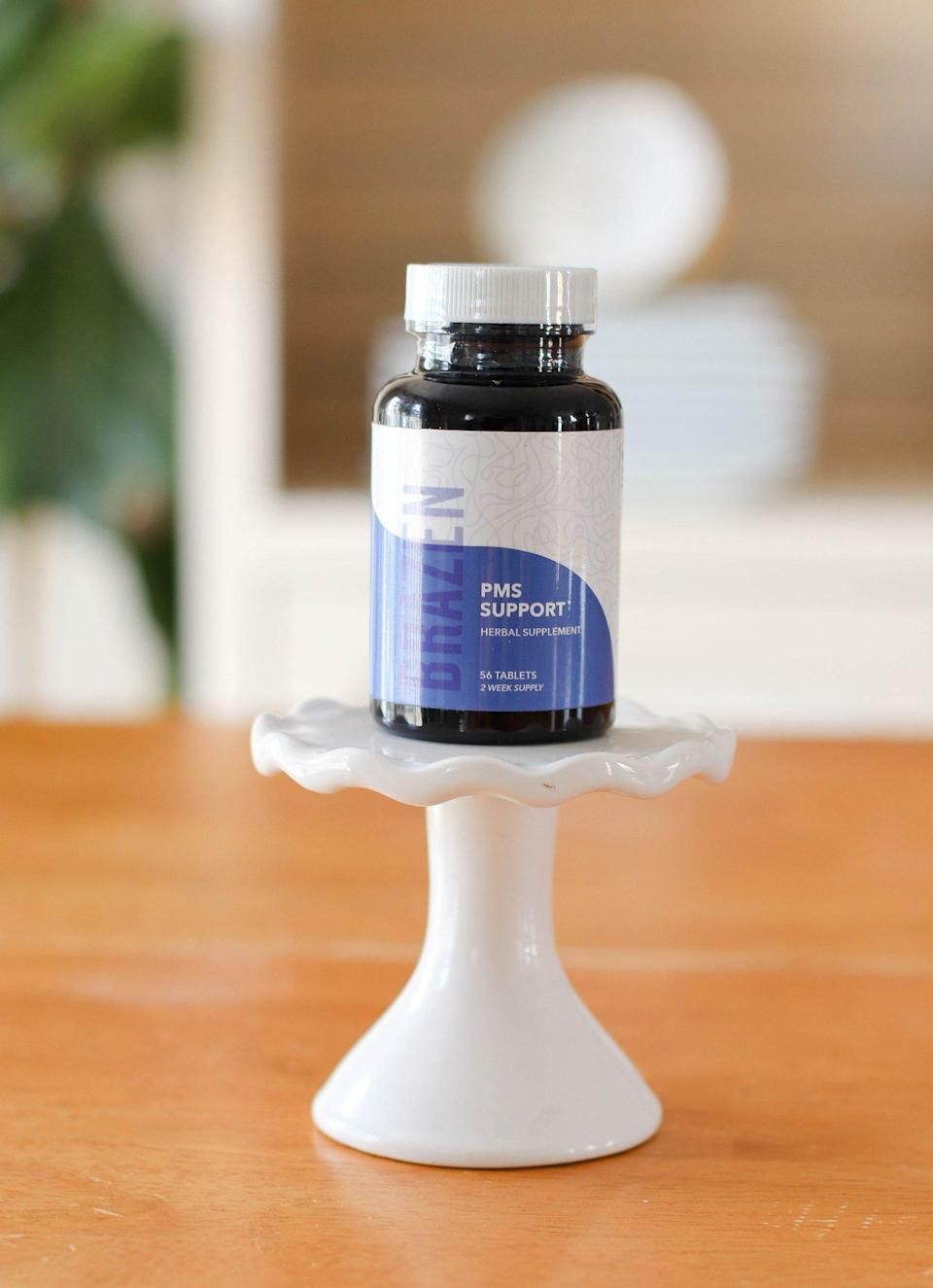 """<p>This herbal formula was developed by <a href=""""https://kirstenkarchmer.com/"""" rel=""""nofollow noopener"""" target=""""_blank"""" data-ylk=""""slk:Kirsten Karchmer"""" class=""""link rapid-noclick-resp"""">Kirsten Karchmer</a>, an acupuncturist who has dedicated her career to helping women with PMS and PMDD.</p> <p>Karchmer tells PEOPLE poor digestion is one of the common reasons women experience painful symptoms, and our tester (who has tried everything, previously with little success) had positive results. She noticed less bloating after trying the formula for two months.</p> <p>Consult with your doctor if you are taking prescription medications. If you get the all-clear, Karchmer recommends taking two tablets a day starting 14 days before your period. </p> <p><a href=""""https://foreverbrazen.com/shop"""" rel=""""nofollow noopener"""" target=""""_blank"""" data-ylk=""""slk:Brazen PMS Support, $29.99"""" class=""""link rapid-noclick-resp"""">Brazen PMS Support, $29.99</a></p>"""