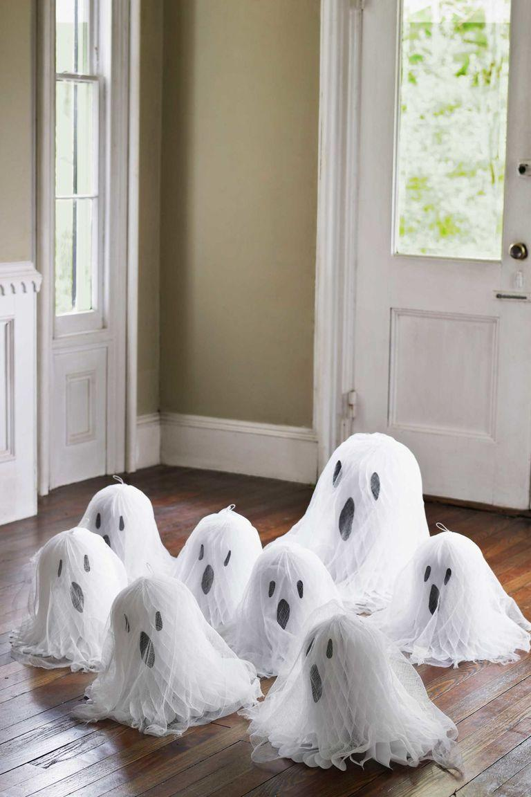 """<p>Follow a few simple steps to transform tissue paper bells into scary ghosts for your dining table. </p><p><em><a href=""""https://www.countryliving.com/diy-crafts/g1189/best-halloween-crafts-ever/?slide=20&thumbnails="""" rel=""""nofollow noopener"""" target=""""_blank"""" data-ylk=""""slk:Get the tutorial at Country Living >>"""" class=""""link rapid-noclick-resp"""">Get the tutorial at Country Living >></a></em></p><p><a class=""""link rapid-noclick-resp"""" href=""""https://www.amazon.com/Darice-VL8143851F-Bridal-Tissue-15-Inch/dp/B0054G69JQ/?tag=syn-yahoo-20&ascsubtag=%5Bartid%7C10055.g.33437890%5Bsrc%7Cyahoo-us"""" rel=""""nofollow noopener"""" target=""""_blank"""" data-ylk=""""slk:SHOP TISSUE PAPER BELLS"""">SHOP TISSUE PAPER BELLS</a></p>"""