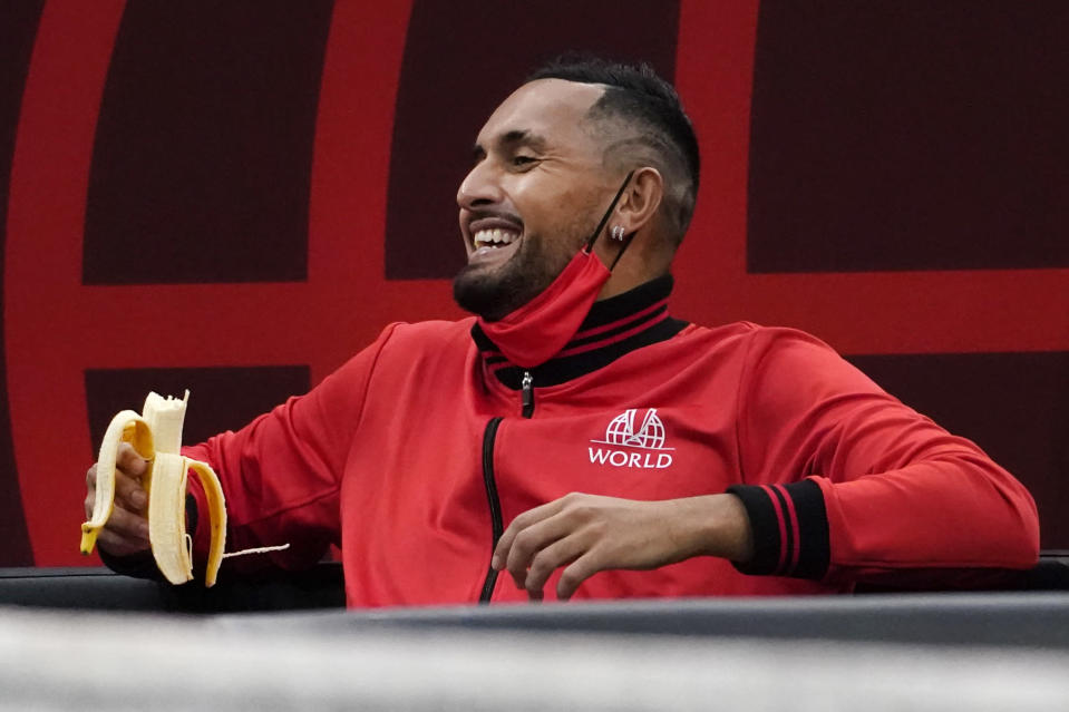 Team World's Nick Kyrgios, of Australia, laughs with teammates on the bench as they watch Team World's John Isner, of the USA, compete against Team Europe's Alexander Zverev, of Germany, during Laver Cup tennis, Saturday, Sept. 25, 2021, in Boston. (AP Photo/Elise Amendola)