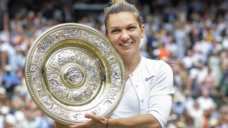Simona Halep with the trophy after winning the Wimbledon final. (Photo by Tim Clayton/Corbis via Getty Images)