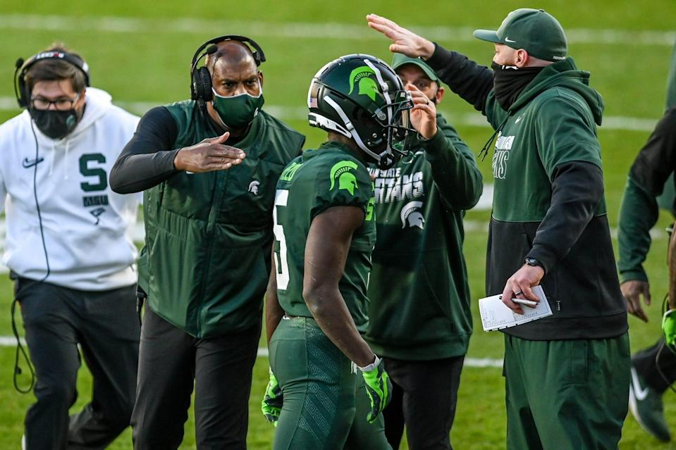 Michigan State's head coach Mel Tucker, left, congratulates Jayden Reed after his touchdown against Northwestern during the second quarter on Saturday, Nov. 28, 2020, at Spartan Stadium in East Lansing.