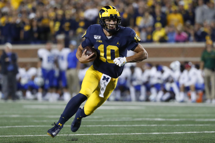 Michigan quarterback Dylan McCaffrey runs the ball in the second half of the team's NCAA college football game against Middle Tennessee in Ann Arbor, Mich., Saturday, Aug. 31, 2019. (AP Photo/Paul Sancya)