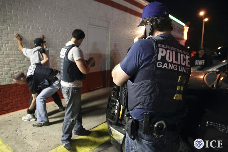 Federal agents with the U.S. Immigration and Customs Enforcement's (ICE) Homeland Security Investigations (HSI) detain a man in this handout picture taken in Dallas, Texas March 30, 2014 and released May 1, 2014. U.S. authorities have arrested 638 suspected gang members in a month-long sweep named Project Southbound aimed at associates of the fast-growing network of Surenos street gangs, an international criminal gang that started in Southern California, Immigration and Customs Enforcement said on Thursday. REUTERS/ICE/Charles Reed/Handout via Reuters (UNITED STATES - Tags: CRIME LAW) ATTENTION EDITORS - THIS PICTURE WAS PROVIDED BY A THIRD PARTY. REUTERS IS UNABLE TO INDEPENDENTLY VERIFY THE AUTHENTICITY, CONTENT, LOCATION OR DATE OF THIS IMAGE. THIS PICTURE IS DISTRIBUTED EXACTLY AS RECEIVED BY REUTERS, AS A SERVICE TO CLIENTS. FOR EDITORIAL USE ONLY. NOT FOR SALE FOR MARKETING OR ADVERTISING CAMPAIGNS