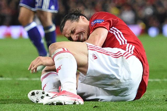Manchester United's Swedish striker Zlatan Ibrahimovic reacts after falling awkwardly during the UEFA Europa League quarter-final match against Anderlecht at Old Trafford in Manchester on April 20, 2017 (AFP Photo/Oli SCARFF )
