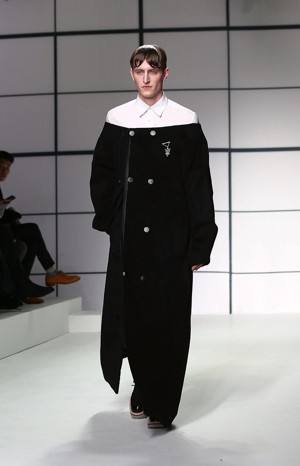 """<div class=""""caption-credit""""> Photo by: Tim Whitby/Getty Images</div>Forget St. Nick, the shoulder-bearing overcoat from Xander Zhou's collection took its inspiration from Franciscan monks. <br>"""