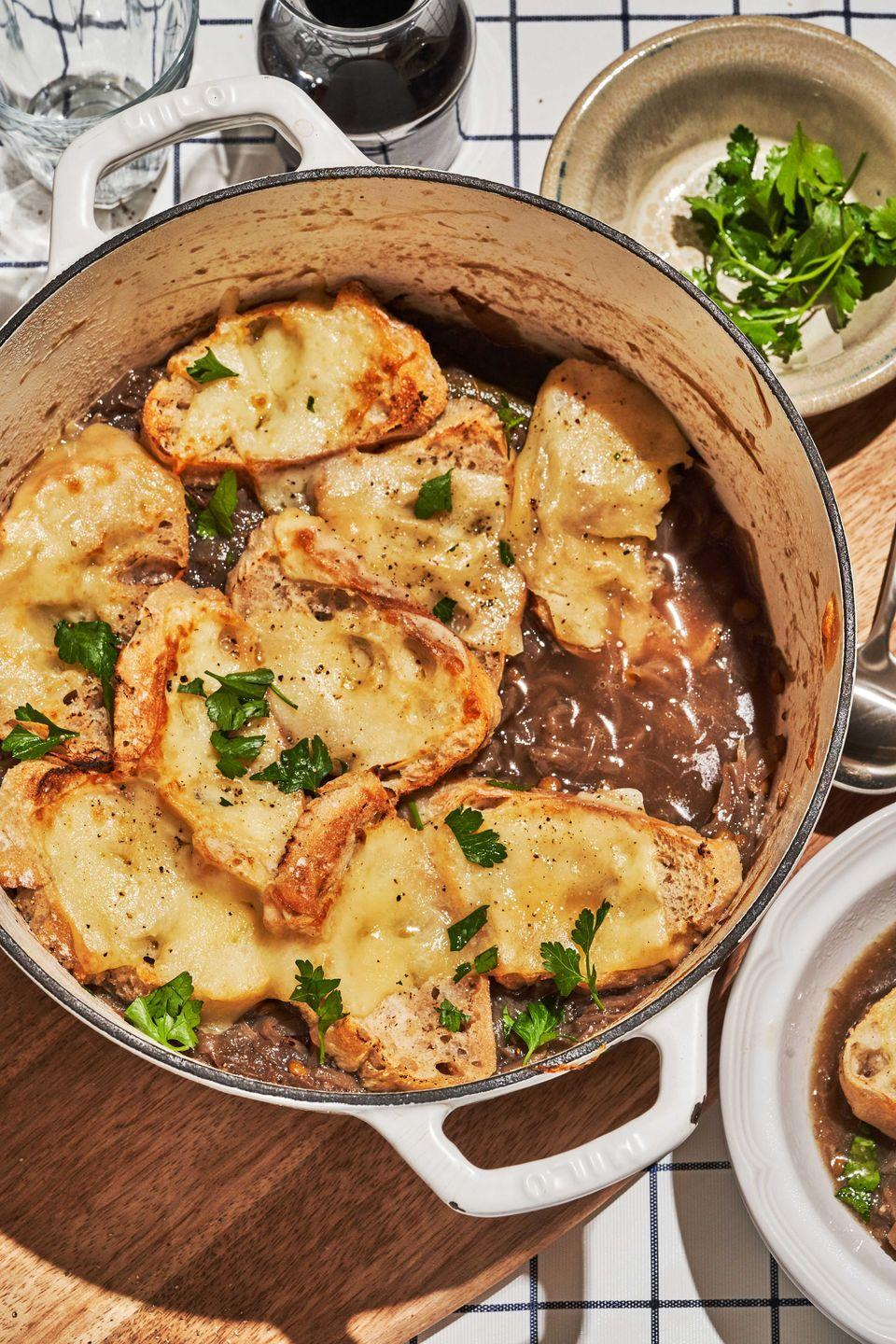 """<p>Pro tip: prep the cheese toasts on a sheet tray in advance to avoid soggy pieces of bread in your leftovers.</p><p>Get the recipe from <a href=""""https://www.delish.com/cooking/recipe-ideas/a36972937/vegan-french-onion-soup-recipe/"""" rel=""""nofollow noopener"""" target=""""_blank"""" data-ylk=""""slk:Delish"""" class=""""link rapid-noclick-resp"""">Delish</a>. </p>"""