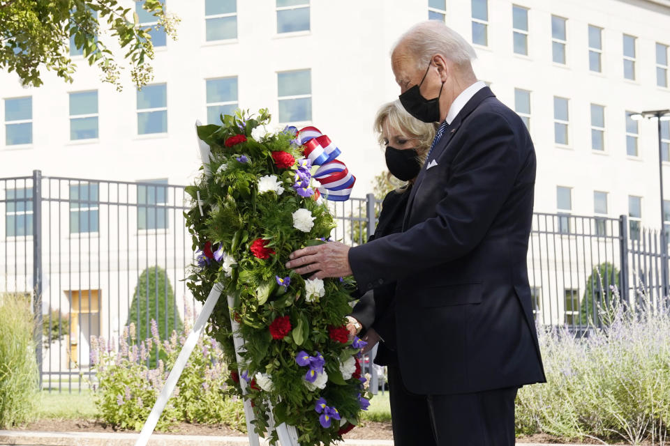 President Joe Biden and first lady Jill Biden participate in a wreath ceremony on the 20th anniversary of the terrorist attacks at the Pentagon in Washington, Saturday, Sept. 11, 2021, standing at the National 9/11 Pentagon Memorial site, which commemorates the lives lost at the Pentagon and onboard American Airlines Flight 77. With the President, not shown, are Vice President Kamala Harris and her husband Douglas Emhoff, Secretary of Defense Lloyd Austin and Joint Chiefs Chairman Gen. Mark Milley and his wife Hollyanne Milley. (AP Photo/Alex Brandon)