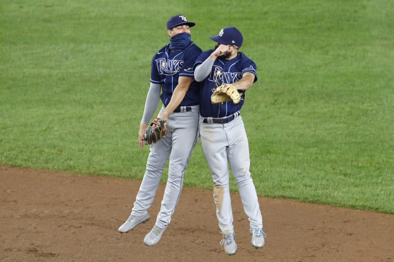 Tampa Bay Rays shortstop Willy Adames (1) celebrates with second baseman Brandon Lowe (8) after the Rays 4-2 victory over the New York Yankees in a baseball game, Wednesday, Aug. 19, 2020, in New York. (AP Photo/Kathy Willens)