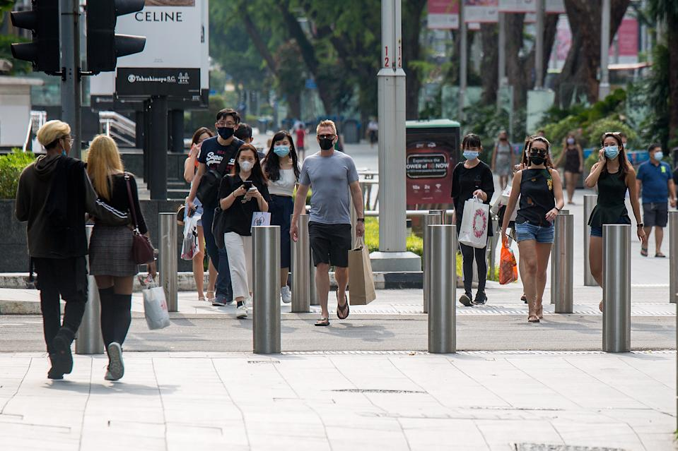 People seen along Orchard Road on 24 May 2021 amid Singapore's Phase 2 (Heightened Measures) period. (PHOTO: Dhany Osman / Yahoo News Singapore)
