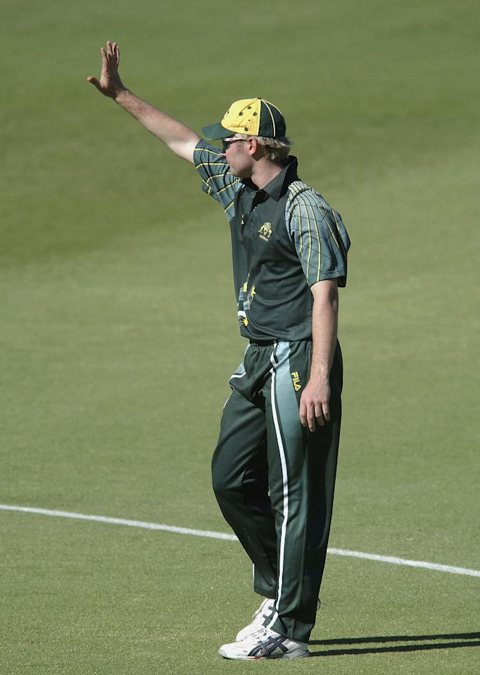 PERTH, AUSTRALIA - JANUARY1:  Captain of Australia A Michael Clarke sets up his field placement during the match between Australia A and Zimbabwe at the WACA on January 1, 2004 in Perth, Australia. (Photo by Jon Buckle/Getty Images)