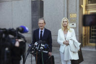 Attorneys David Boies, left, and Sigrid McCawley speak following Ghislaine Maxwell's appearance in Federal Court on Friday, April 23, 2021, in New York. Ghislaine Maxwell, a British socialite and one-time girlfriend of Epstein, pleaded not guilty to sex trafficking conspiracy and an additional sex trafficking charge that were added in a rewritten indictment released last month by a Manhattan federal court grand jury. (AP Photo/Kevin Hagen)