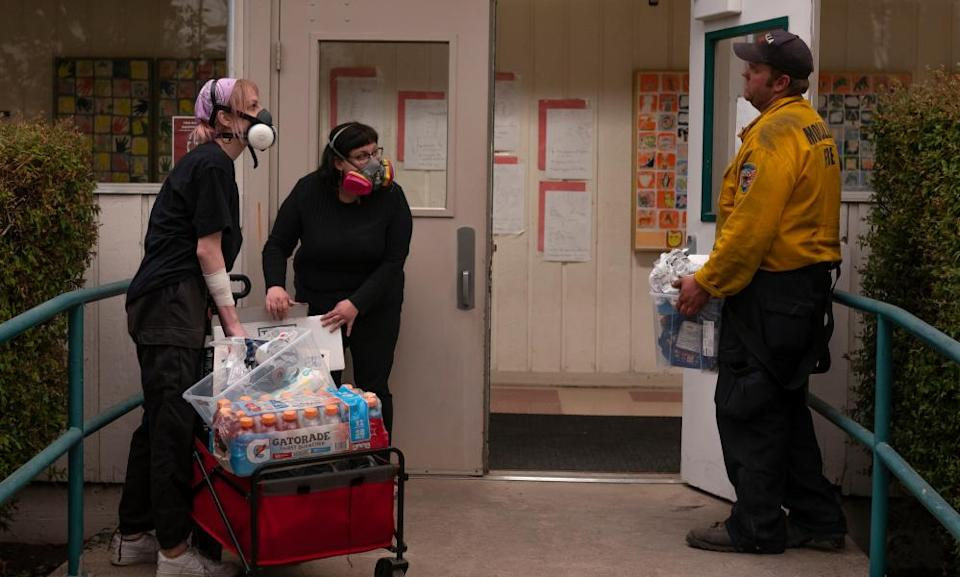 Volunteers with the Portland mutual aid group PDX Witches deliver donated supplies to a fire command center on Thursday in Molalla.