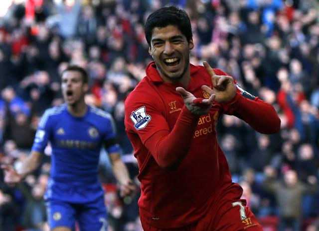 """Liverpool's Luis Suarez celebrates his goal against Chelsea during their English Premier League soccer match at Anfield in Liverpool, northern England, in this April 21, 2013 file photo. Barcelona have agreed to buy Suarez from Liverpool, the two clubs said on July 11, 2014. REUTERS/Phil Noble/Files (BRITAIN - Tags: SPORT SOCCER)FOR EDITORIAL USE ONLY. NOT FOR SALE FOR MARKETING OR ADVERTISING CAMPAIGNS. NO USE WITH UNAUTHORIZED AUDIO, VIDEO, DATA, FIXTURE LISTS, CLUB/LEAGUE LOGOS OR """"LIVE"""" SERVICES. ONLINE IN-MATCH USE LIMITED TO 45 IMAGES, NO VIDEO EMULATION. NO USE IN BETTING, GAMES OR SINGLE CLUB/LEAGUE/PLAYER PUBLICATIONS"""