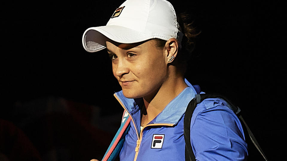 Ash Barty is pictured walking onto the court at the 2020 Qatar Open.