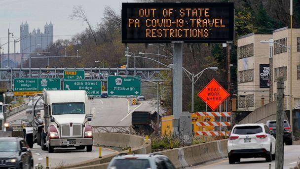 PHOTO: A sign over route 28 north of downtown Pittsburgh alerts out of state motorists to Pennsylvania Covid-19 travel restrictions on Nov. 24, 2020. (Gene J. Puskar/AP)