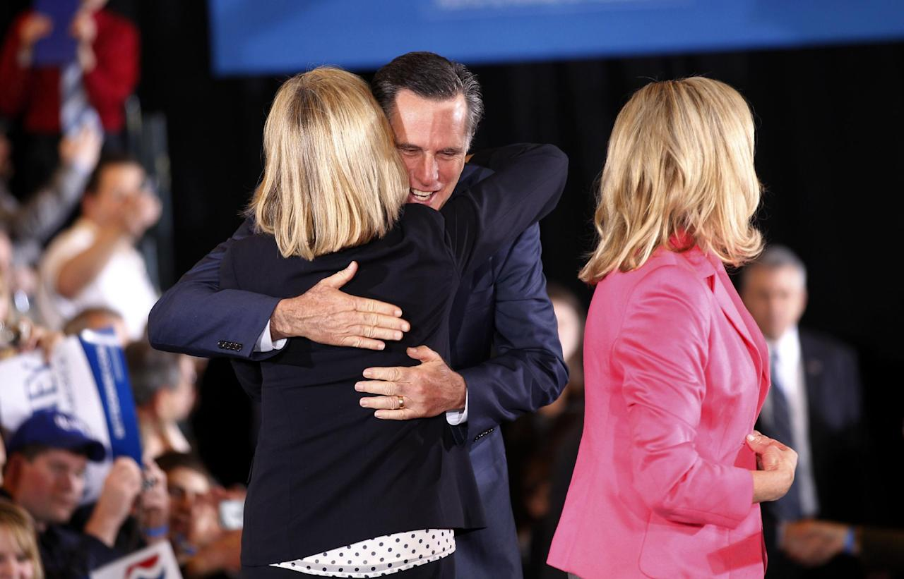 Republican presidential candidate, former Massachusetts Gov. Mitt Romney, hugs former Mass. Lt. Gov. Kerry Healey, as he and his wife Ann arrive at their Super Tuesday primary watch party in Boston, Tuesday, March 6, 2012. (AP Photo/Gerald Herbert)