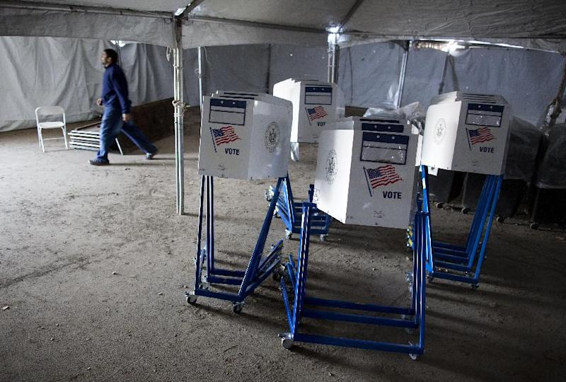 Voting machines rest under a tent that has become a make shift voting locations at PS 180 in the Rockaway neighborhood of the borough of Queens York, Monday, Nov. 5, 2012, in the wake of Superstorm Sandy. Election officials are ordering generators, moving voting locations and figuring out how to transport poll workers displaced from coastal areas as Tuesday's presidential election became the latest challenge for states whacked by Superstorm Sandy. The storm, which devastated East Coast communities with power outages, flooding and snow, had already disrupted early voting in parts of Maryland, West Virginia, New Jersey and North Carolina. (AP Photo/Craig Ruttle)