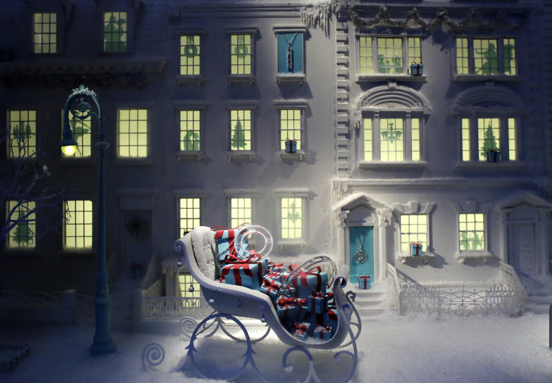 FILE - This Nov. 20, 2013, file photo, shows a sleigh filled with gift-wrapped jewelry boxes in a holiday window at Tiffany & Co., in New York. Tiffany & Co. reports earnings before U.S. stock markets open on Tuesday, Sept. 26, 2013. (AP Photo/Mark Lennihan, File)