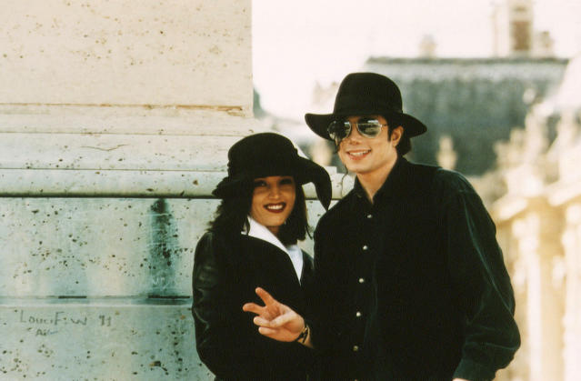 """<p>Twenty days after her divorce, Presley married Michael Jackson. They had actually first been introduced by her father — Elvis took Lisa Marie to a Jackson 5 concert in Las Vegas when she was 7 and Michael was 17. She told Diane Sawyer that she found Jackson to be a """"poor, sweet, misunderstood man"""" amid his sexual abuse scandal, and said to herself that she would """"save"""" him when they reconnected in 1992. (Photo: Stephane Cardinale/Sygma via Getty Images) </p>"""