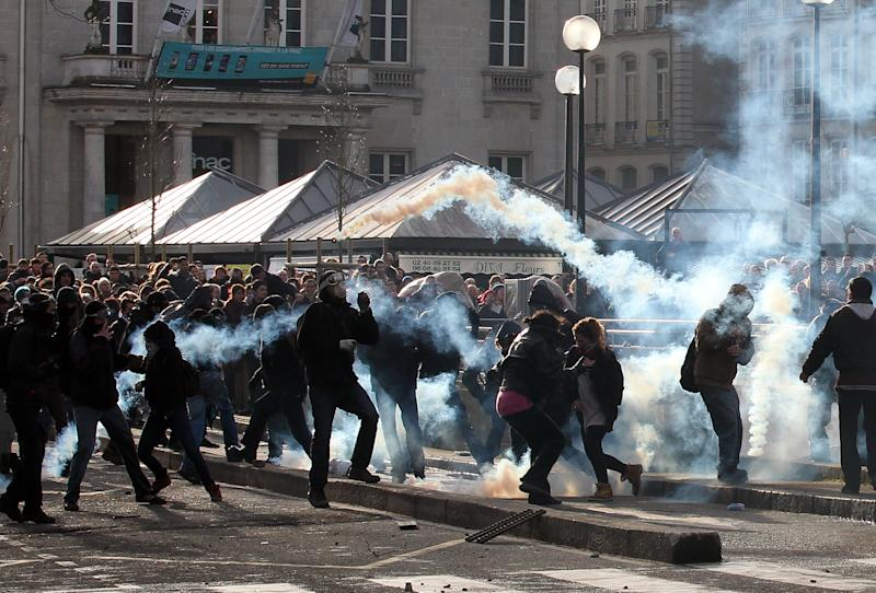 Demonstrators clash with French riot police during a demonstration in Nantes, Saturday Feb. 22, 2014, as part of a protest against a project to build an international airport, in Notre Dame des Landes, near Nantes. The project was decided in 2010 and the international airport should open by 2017. (AP Photo/ Laetitia Notarianni)