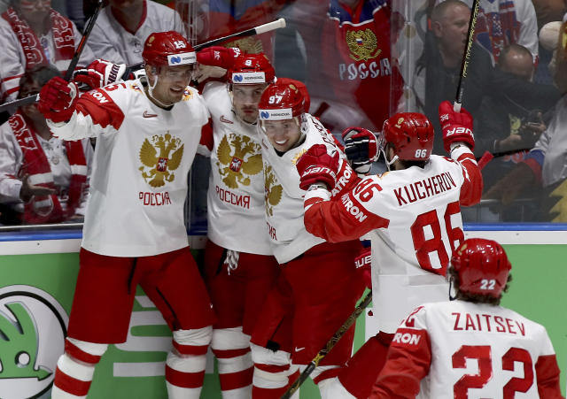 Russia players celebrate after scoring during the Ice Hockey World Championships group B match between Switzerland and Russia at the Ondrej Nepela Arena in Bratislava, Slovakia, Sunday, May 19, 2019. (AP Photo/Ronald Zak)