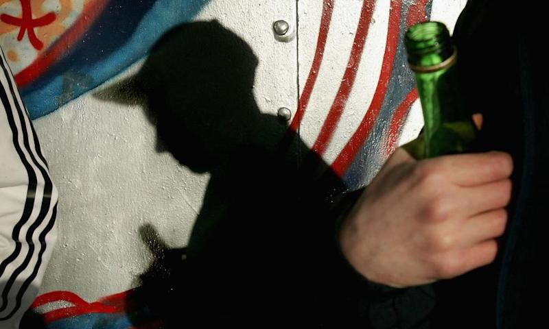 Silhouette of a young boy drinking from a bottle