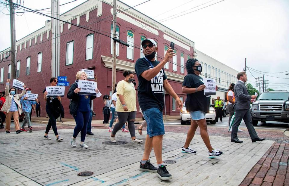 Around 150 demonstrators march Saturday, June 12, 2021 in Elizabeth City calling for a special prosecutor and the release of body-camera footage in the April slaying of Andrew Brown Jr.