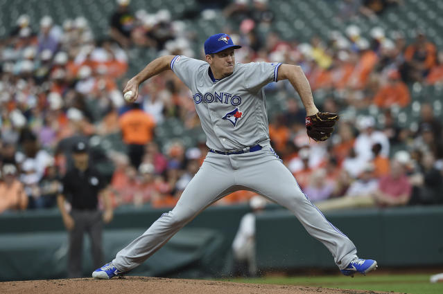 Toronto Blue Jays pitcher Derek Law throws to a Baltimore Orioles batter during the first inning of a baseball game Wednesday, June 12, 2019, in Baltimore. (AP Photo/Gail Burton)