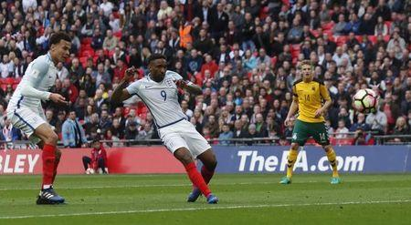 England's Jermain Defoe scores their first goal