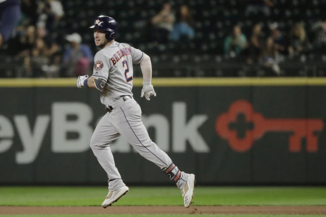 Houston Astros' Alex Bregman rounds the bases after he hit a solo home run during the fourth inning of the team's baseball game against the Seattle Mariners, Tuesday, Sept. 24, 2019, in Seattle. (AP Photo/Ted S. Warren)
