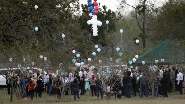 Balloons are released at a graveside service last week for members of the Holcombe family who were killed in the Sutherland Springs Baptist Church shooting. (Photo: Eric Gay/AP)