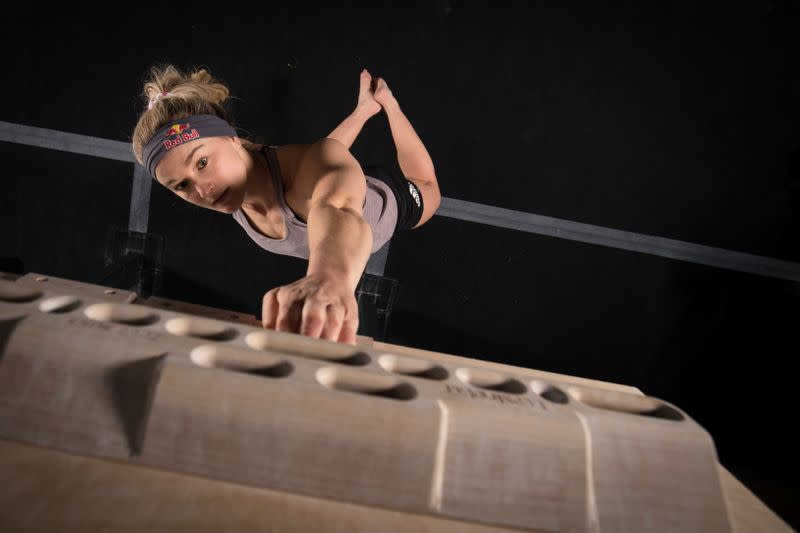Shauna Coxsey trains on a fingerboard at The Climbing Hangar Matchworks in Liverpool
