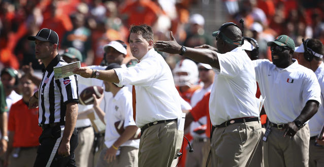 Miami coach Al Golden, left, and his coaching staff argue a penalty call during the second half of an NCAA college football against Wake Forest game in Miami Gardens, Fla., Saturday, Oct. 26, 2013. Miami won 24-21. (AP Photo/J Pat Carter)
