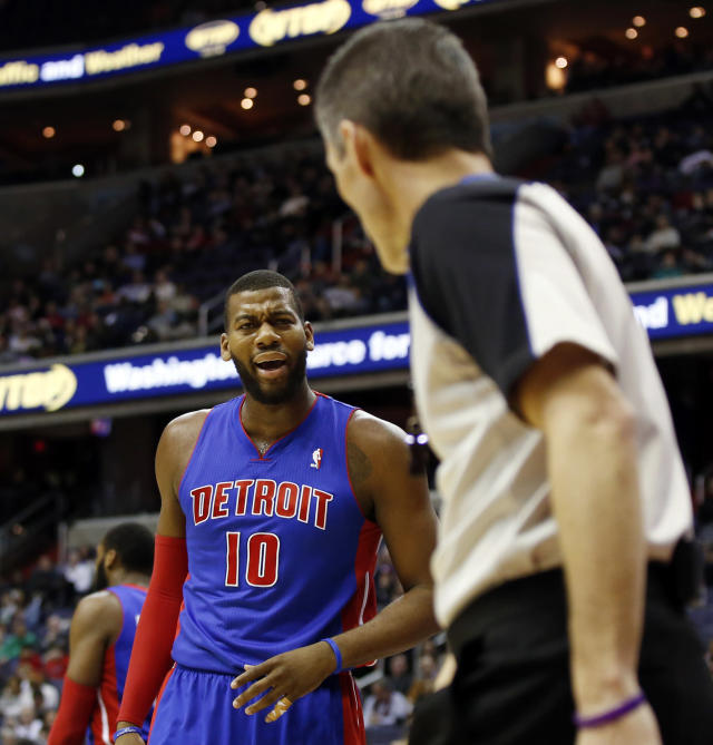 Detroit Pistons forward Greg Monroe (10) questions a call by referee Scott Foster in the first half of an NBA basketball game against the Washington Wizards, Saturday, Jan. 18, 2014, in Washington. (AP Photo/Alex Brandon)