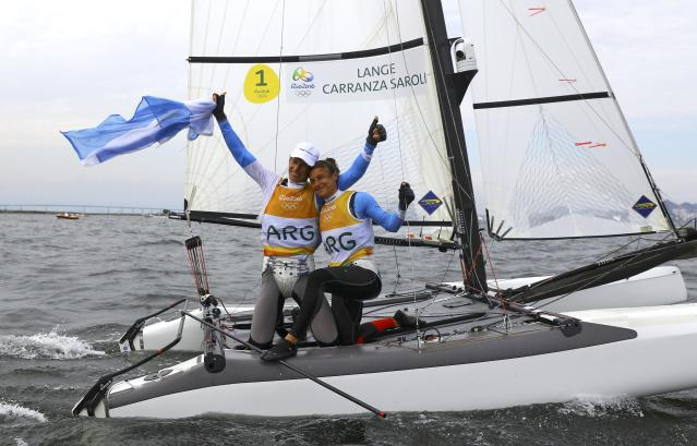 2016 Rio Olympics - Sailing - Final - Mixed Multihull - Nacra 17 - Medal Race - Marina de Gloria - Rio de Janeiro, Brazil - 16/08/2016. Santiago Lange (ARG) of Argentina and Cecilia Carranza (ARG) of Argentina celebrate gold medal. REUTERS/Brian Snyder FOR EDITORIAL USE ONLY. NOT FOR SALE FOR MARKETING OR ADVERTISING CAMPAIGNS.