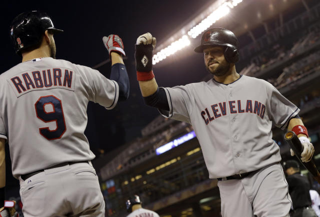 Cleveland Indians' Nick Swisher, right, scores on an RBI-triple hit by Jason Kipnis in the first inning of a baseball game against the Minnesota Twins, Friday, Sept. 27, 2013, in Minneapolis. (AP Photo/Jim Mone)