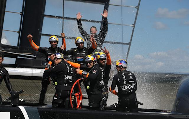 SAN FRANCISCO, CA - SEPTEMBER 25: Oracle Team USA skippered by James Spithill celebrates after they beat Emirates Team New Zealand skippered by Dean Barker in race 19 to win the America's Cup Finals on September 25, 2013 in San Francisco, California. (Photo by Ezra Shaw/Getty Images)