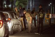 Unidentified relatives of top separatist leader Syed Ali Shah Geelani arrive outside his residence in Srinagar, Indian controlled Kashmir, Thursday, Sept. 2, 2021. Geelani, an icon of disputed Kashmir's resistance against Indian rule and a top separatist leader who became the emblem of the region's defiance against New Delhi, died late Wednesday. He was 92. (AP Photo/Mukhtar Khan)