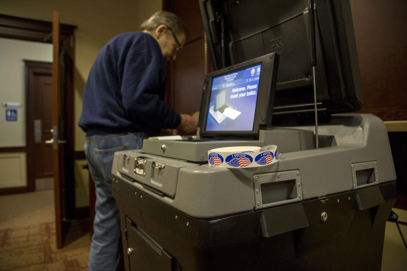 Wisconsin judge holds officials in contempt for defying voter purge