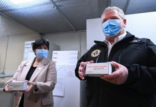 Ontario Premier Doug Ford shows off the Moderna COVID-19 vaccine on Wednesday, December 30, 2020.  (Nathan Denette/Canadian Press - image credit)