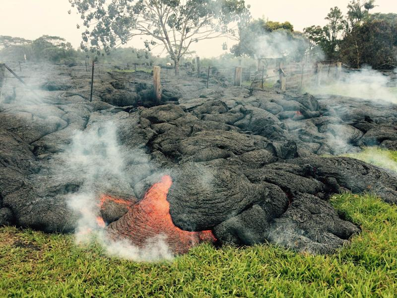 This October 26, 2014 image provided by the US Geological Survey shows the lave flow from the Kilauea volcano in Hawaii