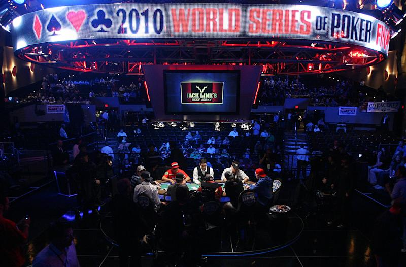 Competitors wait for play to begin at the final table of the World Series of Poker, Saturday, Nov. 6, 2010 in Las Vegas. (AP Photo/Isaac Brekken)